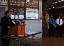 Larry Pope presents cheque to Cudahy Fire Department