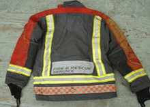 Briston personal protective equipment (PPE) jacket incorporating a Grey/Red Hainsworth®TITAN outershell with a Gore Crosstech Airlock® moisture barrier and Nomex® Delta C lining