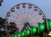 Repaired gondola wheel at playland welcoming people to the park