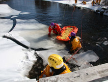 Rescue personnel crawling out over the ice must be aware of the strength and integrity of the ice