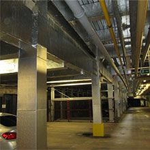 The two-storey car park in Dublin is constructed of steel beams and columns, which includes an innovative car lifting stacker system