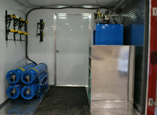 The interior of the hazmat trailer includes an on-board mobile cascade system for refilling air containers, work space, and lockable storage