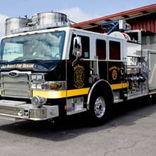 The vehicle's graphics feature Jack Daniel's signature color scheme of black with white and gold accents