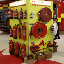 NAFFCO stand exhibiting fire products, including fire hoses and fire extinguishers