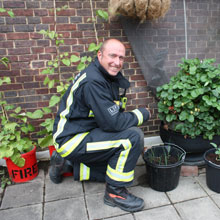 Surbiton firefighters have made their fire station self sufficient by growing their own fruit and vegetables