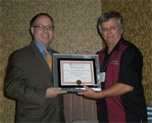 CSB Director of Public Affairs John Horowitz accepts the MERLOT award for the organization's educational safety video,