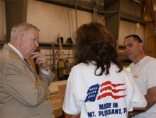 Congressman John P. Murtha (PA-12) listens intently as Mobile Concepts by Scotty production manager Ray Podvorec (right) and company president Anne Degre explain their plans for expansion