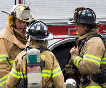 Firefighters discuss tactics onscene: the NVFC and ElanTech, Inc have created an online survey designed to gather data from first responders and aid the design of a new incident command software