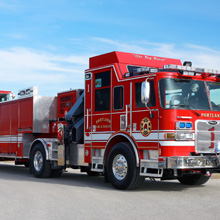The vehicle is built on a Pierce Arrow XT™ chassis with a 16-inch raised roof cab and seating for six firefighters