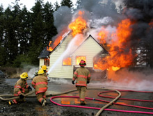 Firefighters tackling a devastating house fire: there were nearly 400,000 such incidents in the US in 2007, according to the NFPA's new report