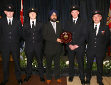 Clun firefighters receiving an award for charity work