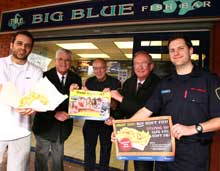 Shropshire FRS officers with chip shop owner Simon Savva (left) outside the chip shop