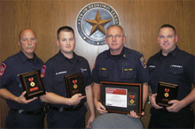 Bedford firefighters honored for saving a life are (from left to right): Lieutenant Mike Swanson, Engineer Jason Whitehead, Chief James Tindell, and Lee Ferguson.