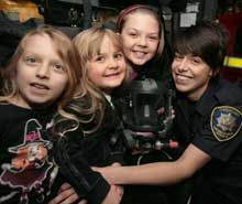Oswestry firefighter Gemma Walters gets over fire safety messages to youngsters Lydia Grazyna, Agata and Julia Bakalorz