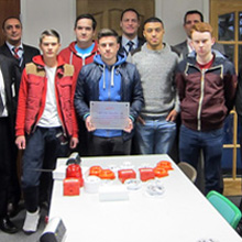 The partnership was marked with the presentation of a plaque in the college's Security & Fire Technology Workshop