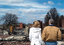Oklahoma Governor Brad Henry and wife, Kim view the devastation caused by the 2009 wildfires in Oklahoma. OK residents have been advised what steps to take to hasten disaster assistance