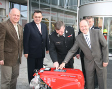 Representatives from ROSENBAUER and Koscian county pose with the second FOX pumps donated by ROSENBAUER