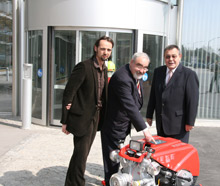 Sales Manager Stefan Gugerbauer, ESEPA President Nikos Sachinidis and ROSENBAUER CEO Julian Wagner pose with the FOX pump ROSENBAUER donated to ESEPA