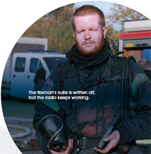 A member of SINE, the Danish public safety network, during situational fire tests on Sepura's STP8000 TETRA radio