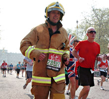 Suffolk fire officer dressed in full fire kit completes 2011 London Marathon