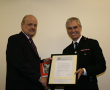Brian Newstead (left) is congratulated by London Fire Commissioner Ron Dobson