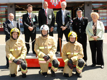 The new fire kit with DFRMO firefighters (foreground) with (back row) from left: Chris Jones; Ian Mitchell; Roger Startin; Terry Brewer; Noel Roberts; Liz Barron
