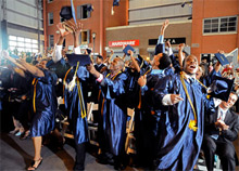 Students at the FDNY Fire and Life Safety high school graduating at a ceremony held on June 25