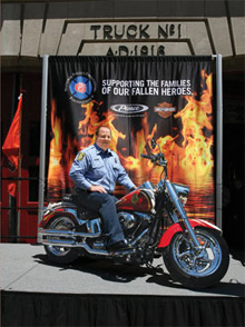 Sweepstakes Grand Prize winner Brian Vickers alongside his Harley-Davidson® Fat Boy® motorcycle as part of the NFFF Full Throttle Support campaign