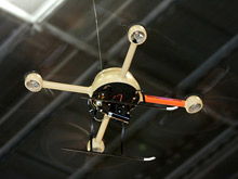 MW Power's Microdrone being flown in the exhibition hall at Fire & Rescue 2009 - the first microUAV to have done so - beaming live images back to partner company VectorCommand's incident management system