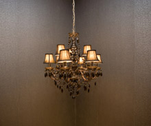 Heavy equipment such as light fixtures hung from ceilings may lead to premature structural failure