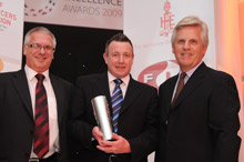 Wilf Butcher, Export Manager, FIA; Tim Maslen, Sales Manager, D-Tec and Steve Rider, TV sports presenter at the Fire Excellence Awards, where D-Tec won the Export Innovation category