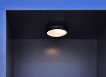 The UK's ESC recommends downlighters with integral fire protection for ceilings where the lining is the only means of keeping fire out of the cavity