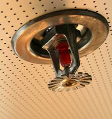 MPs in the House of Commons have started a debate on the need for fire sprinklers in UK schools