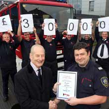Shropshire Fire and Rescue Service celebrated after receiving a Certificate of Appreciation praising their charity efforts from the Chief Executive of the Fire Fighters Charity