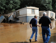 FEMA and GEMA officials tour a flooded mobile home community along Douglas County Sweetwater Creek, Georgia. Federal assistance to the state has now topped $40 million.