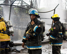Firefighters on scene in Puerto Rico, in the area hit by fire and explosions beginning on October 23, 2009