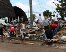 Workers clearing debris in American Samoa. FEMA continues to provide response and federal support to the region.