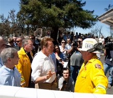 Governor Schwarzeneggar talking to firefighters in California - the Governor has now instructed Cal EMA and CAL FIRE to increase preparations for dealing with wildfire due to hot and dry weather conditions forecast this week