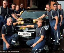 Members of the Greater Manchester Fire and Rescue Service pose during the Fire Fighters Charity National Car Wash which took place on Saturday 19th September at fire stations, raising nearly £20,000