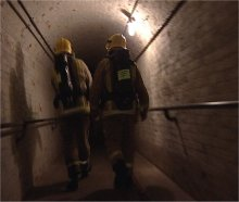 Kent Fire and Rescue Service personnel make their way down one of the Secret Wartime Tunnels within the cliffs of Dover during a drill