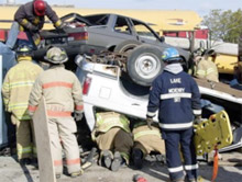 Firefighters performing auto-extrication - NIPSTA is hosting the state-approved Vehicle/Machinery-Technician Level training program in late September