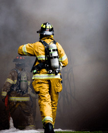 A firefighter walking into the smoke: the NVFC has released a set of guidelines to try and improve health and safety procedures amongst volunteer firefighters