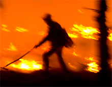 A firefighter working alone in a wildfire. Verizon has increased its wildfire relief efforts to help provide free services for both firefighters and victims of wildfire
