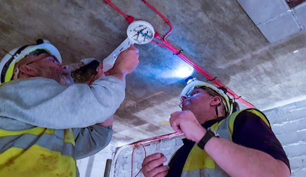 Detector Testers Testing Smoke Detectors With Scorpion Solution