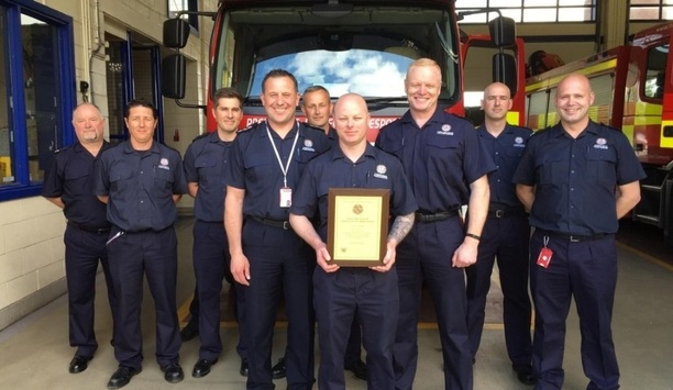 Firefighter Adrian Sargent Presented With A Certificate Of Commendation From TWFRS Chief Fire Officer